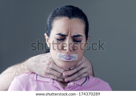 Woman being socially abused by her husband - stock photo