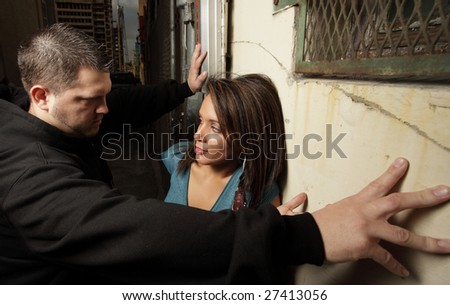 Woman being suppressed by a gang member - stock photo