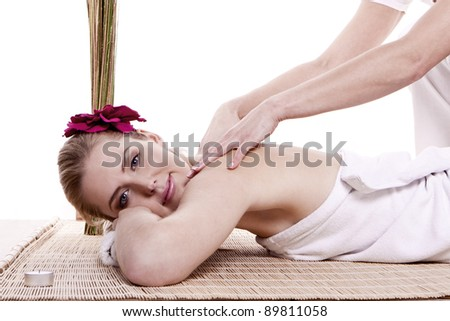 Woman being treated with a massage at a spa. Spa treatment.