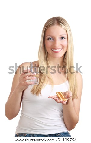 Woman belly with birth control pills - stock photo