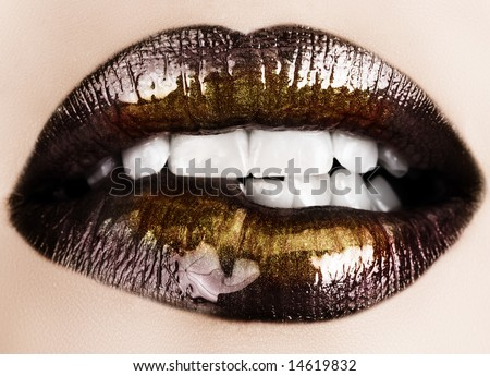 Woman biting her lips with black glossy lipstick and gold powder shine - stock photo
