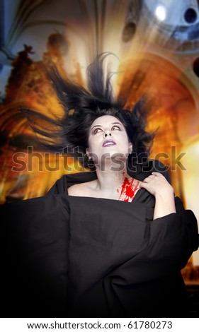 Woman bitten by a vampire - stock photo