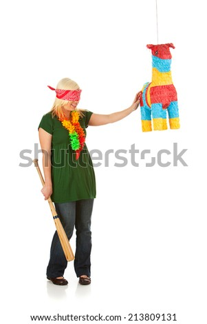Woman Blindfolded And Ready To Take A Swing At Pinata - stock photo