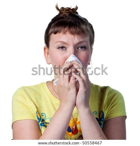 Woman blowing her nose, struggling with allergies - stock photo