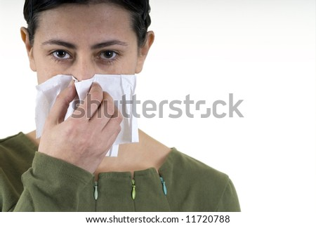 woman blowing her nose with white handkerchief - stock photo