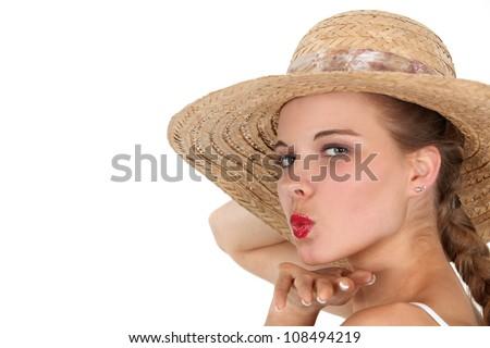 Woman blowing kiss - stock photo