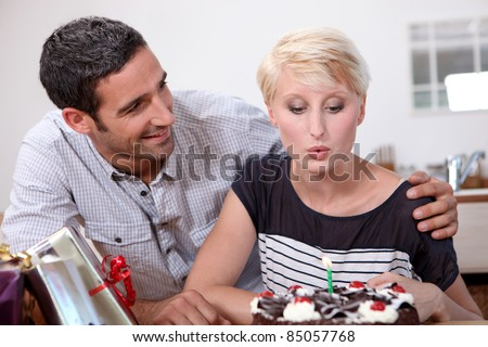Woman blowing out a candle on her birthday
