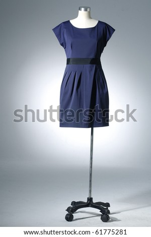 Woman blue cloth on mannequin on light background - stock photo