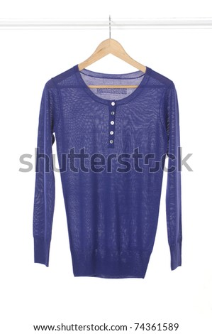 Woman blue clothes on a hanger studio - stock photo