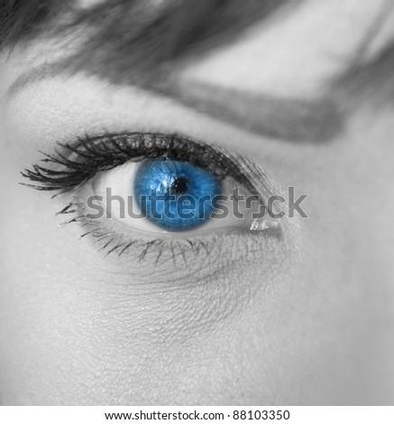 Woman blue eye macro - stock photo