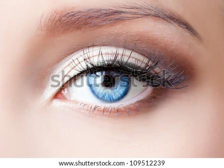 Woman blue eye with extremely long eyelashes - stock photo