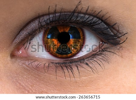 woman blue eye with radioactive sign - stock photo