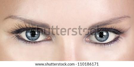 Woman blue eyes with beautiful long eyelashes - stock photo