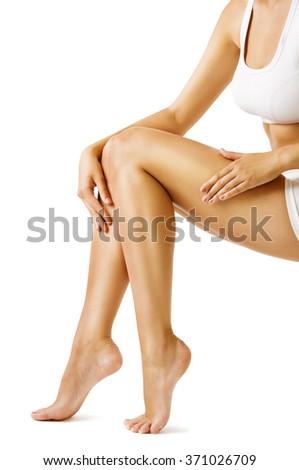 Woman Body Legs Beauty, Model Sitting on White, touch Leg Skin - stock photo