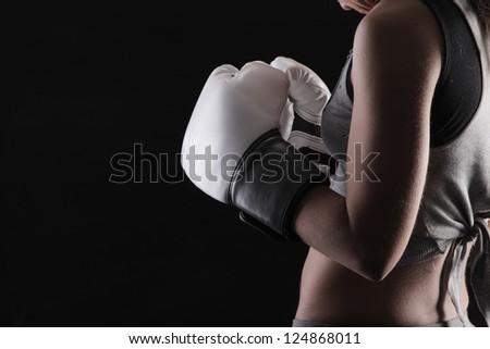 Woman boxer on black background - stock photo
