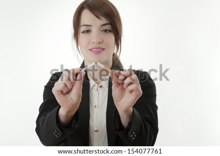 Woman breaking a cigarette - stock photo
