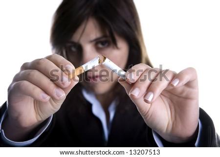 woman breaking cigar - anti-tobacco concept - stock photo
