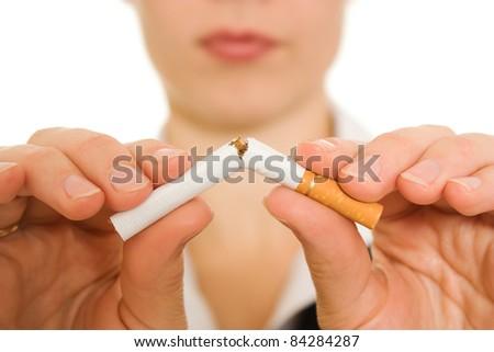 Woman breaks down the cigarette. - stock photo