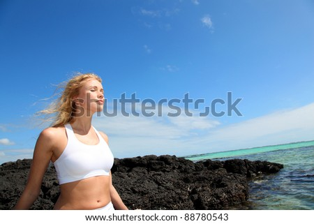 Woman breathing by the sea - stock photo