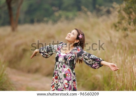 woman breathing in wild nature park, thailand - stock photo