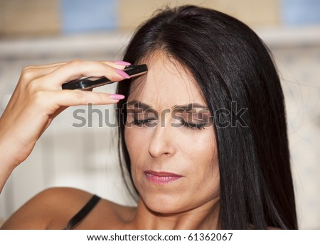 woman bringing your head and remember that she forgot something - stock photo