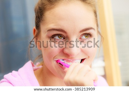 Woman brushing cleaning teeth. Girl with toothbrush in bathroom. Oral hygiene. - stock photo