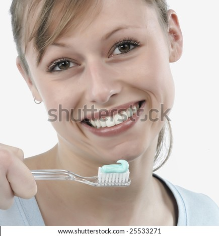 woman brushing her teeth, studio white - stock photo