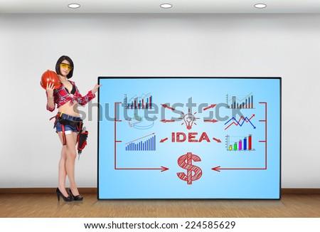woman builder holding plasma panel with idea concept - stock photo