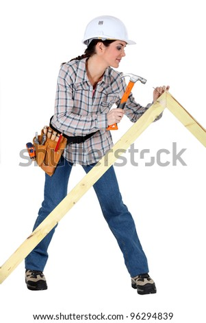 Woman building a frame - stock photo
