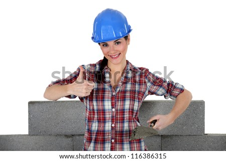 Woman building wall - stock photo