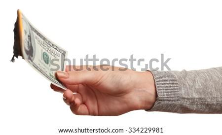 Woman burning dollar banknotes isolated on white - stock photo