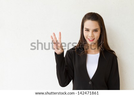woman business executive showing 3 or three fingers hand gesture - stock photo