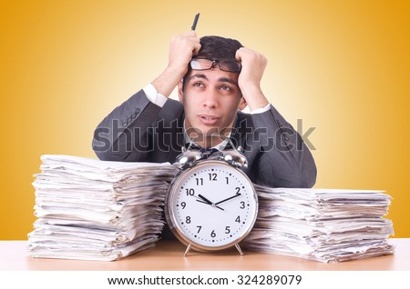 Woman businessman with giant alarm clock - stock photo