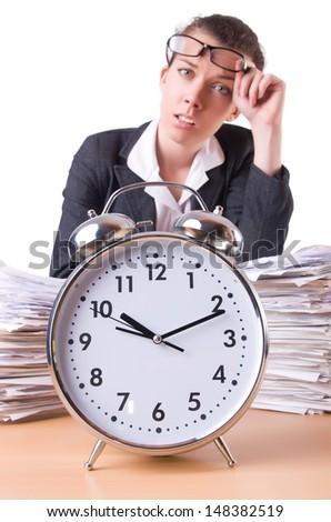 Woman businesswoman with giant alarm clock - stock photo