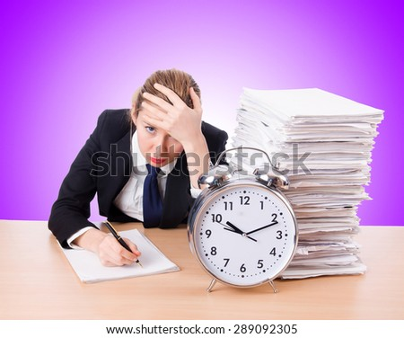 Woman businesswoman with giant alarm clock - stock photo