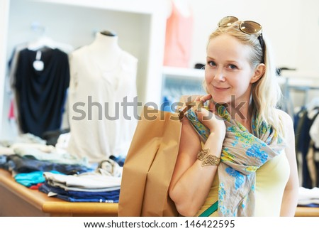 woman buyer with apparel purchase during garments clothing shopping at clothes store - stock photo