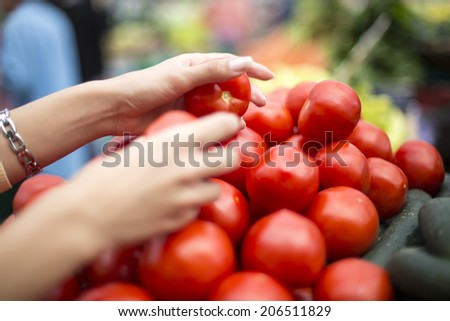 Woman buying fresh vegetables on the market