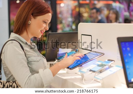 Woman buys a digital tablet - stock photo