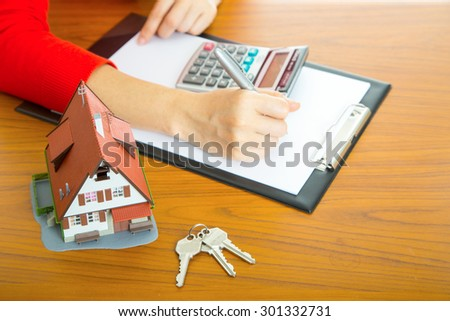 Woman calculate and plan for your good property with real agency property - stock photo