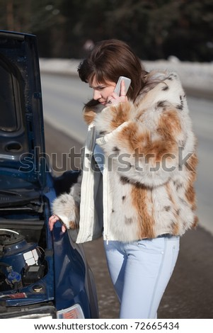 Woman calling by mobile to auto support - stock photo
