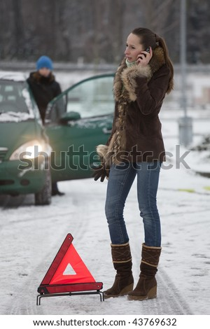 woman calling car service by breakdown on the road - stock photo