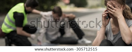 Woman calling for police after car accident - stock photo