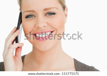 Woman calling with a smartphone against white background