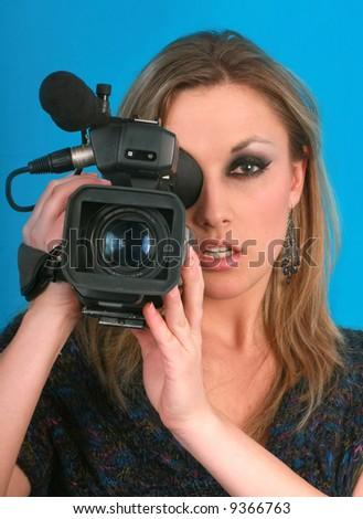 woman camera face closeup video operator prosessional occupation - stock photo