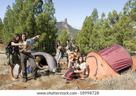 woman camping at the mountains - stock photo