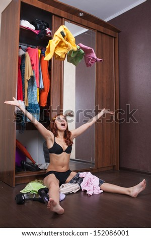 woman can not choose what to wear - stock photo