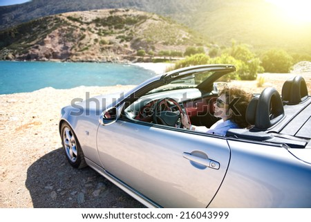 Woman car on vacation - stock photo