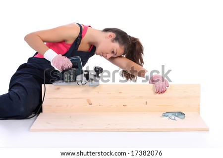 woman carpenter at work on white background - stock photo