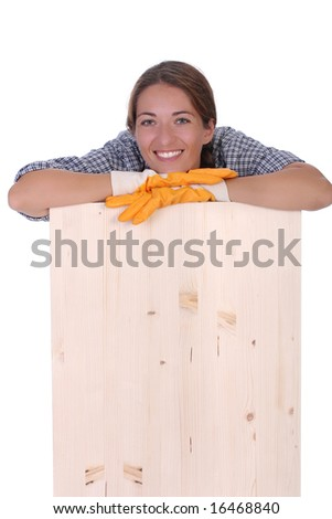 woman carpenter holding wooden plank on white background - stock photo