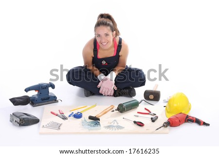 woman carpenter with work tools on wooden plank - stock photo
